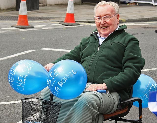 wheelchair-disabled-man-in-parade-CC Feggy Art