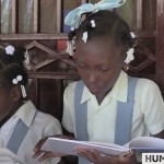 HaitianKidsReceivingBooks FaceBook screen shot4