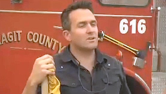 Lawyer Alex Thomason 2 with fire truck screenshot KHQ
