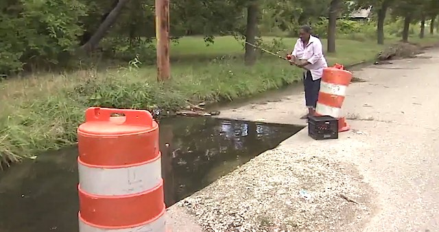 Pothole becomes fish pond screenshot WJBK