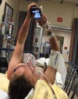 Sam-Ray-famiyphoto-hospital-cell-phone