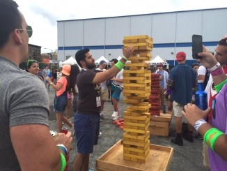 90s fest guy with giant jenga Helaina Hovitz