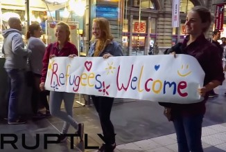 Refugees Welcome sign-germany-RuptlyYoutube