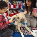 child-petting-dog-SitStayRead-Facebook