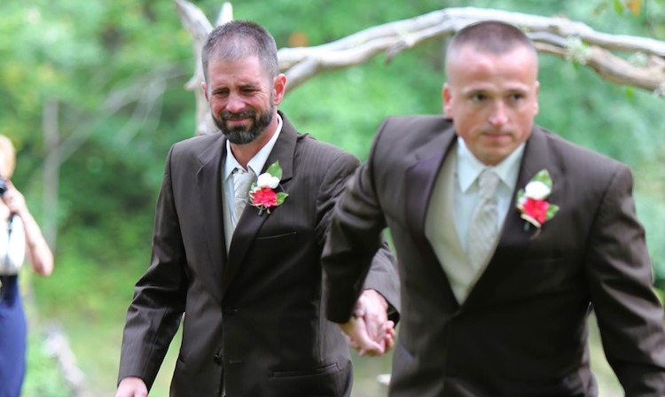 stepdad and dad down aisle copyright Delia D Blackburn Photography