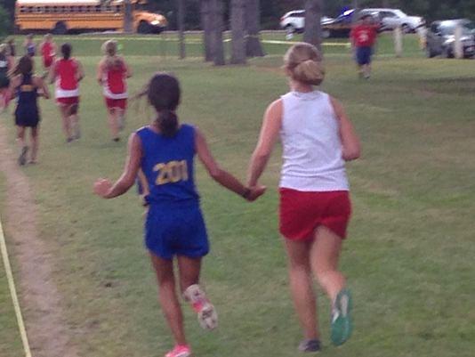 teen-runner-helps-opponent-permission-from-SteveClark