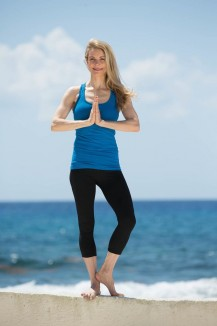 woman yoga tree pose AcaciaTV submitted