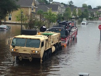 South Carolina National Guard pull stalled rescue vehicles from floodwaters