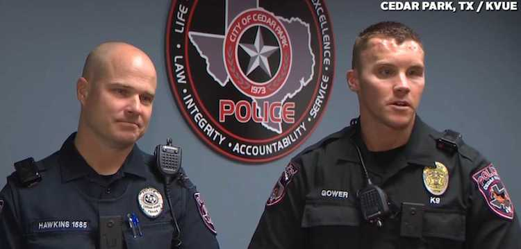 two cops carseats KVUE video screenshot