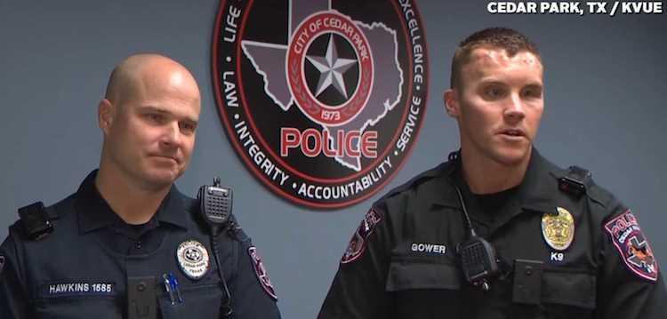 two cops carseats KVUE video screenshot