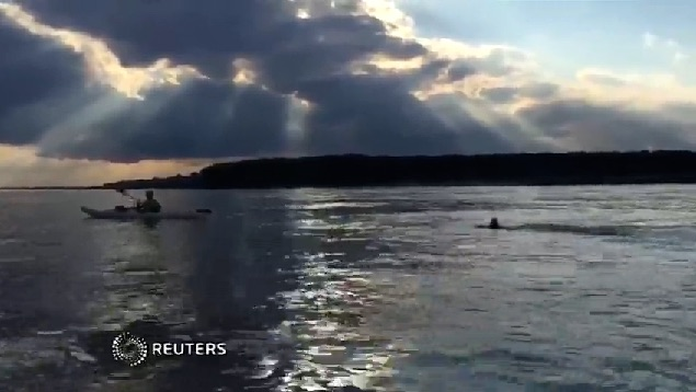 Chris Ring swims mississippi-LegaciesAlive-Reuters-video-permission