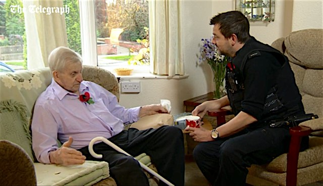 Cop comforts elderly man Screenshot ITV news