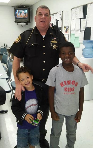 police-deputy-Brian-Bussell-with-kids-Facebook