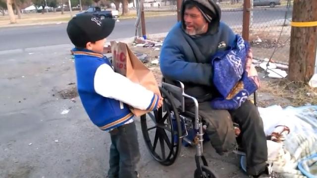 boy helps homeless for Christmas screenshot YouTube