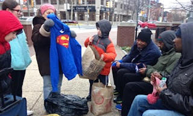 giving-sweaters-to-homeless-submitted