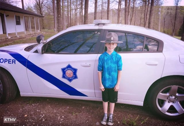 boy with patrol car-toxy family photo