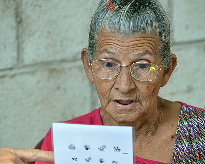 senior gets eye glasses-International Relief Teams