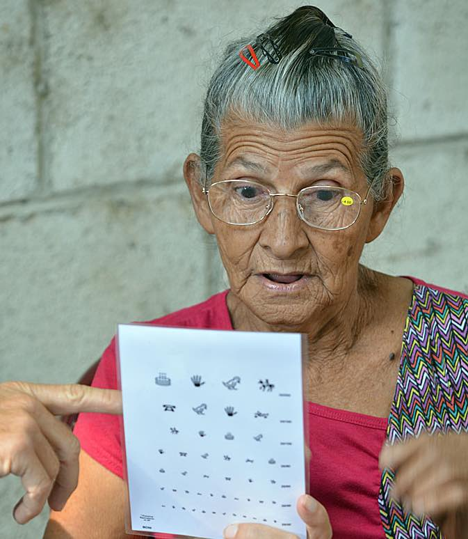 senior gets eyeglasses-tall-International Relief Teams