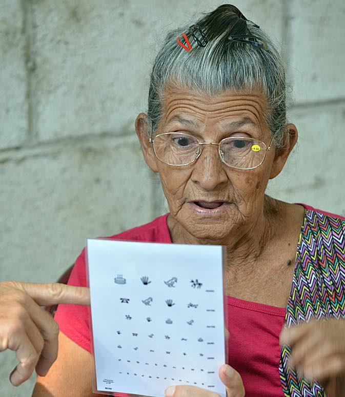 senior gets eyeglasses-tall-International Relief Teams