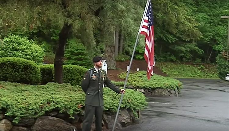Soldier Holds Flag on Memorial Day screenshot WWLP