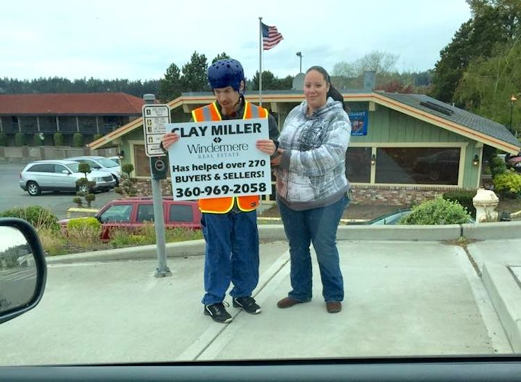 disabled carey carries signs-submitted photo