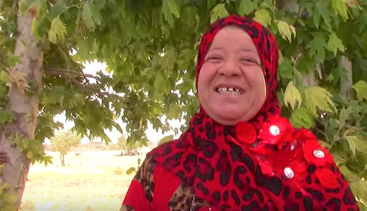 Kurdish Woman Wears Only Red screenshot ANHA