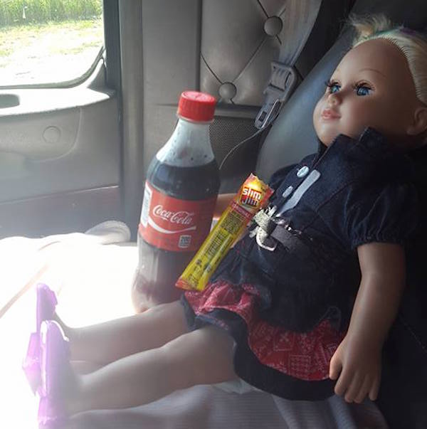 doll in car with coke-McCain Trucking-permission