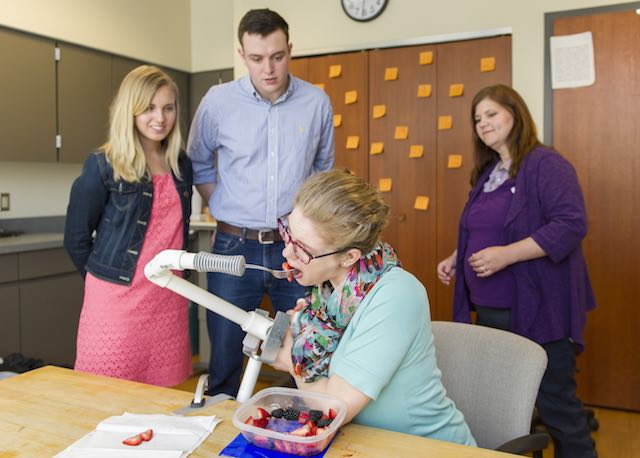 Notre Dame students Emily Cunningham, Michael Boyle and occupational therapist Heather Beaver work with patient Katelyn Toth