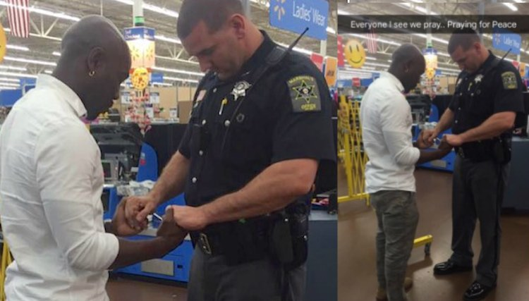 Officer Clinton Powell prays with black shopper-FB