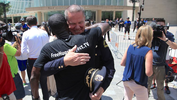 free hugs project with policeman-youtube