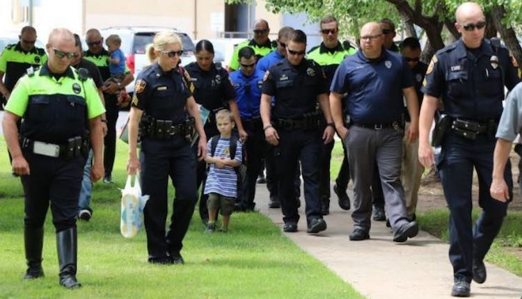 Cops Escort Boy -Amarillo Independent School District
