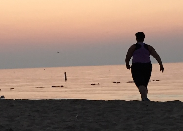 Obese Woman Runs for exercise on Beach