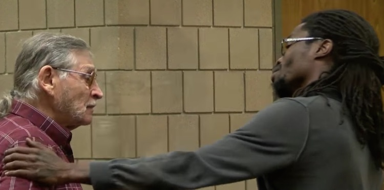 Aggressor and Victim Hug in Court