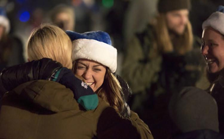 two-people-hugging-cnw-groupwestjet