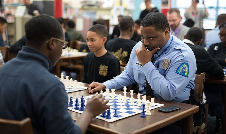Cop Playing Chess-Austin Fuller