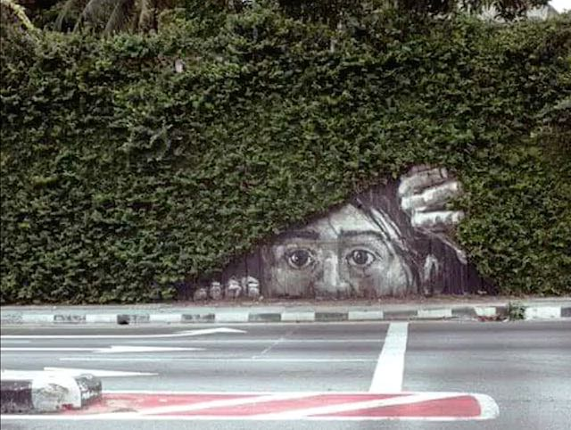"Lithuania-based artist Ernest Zacharevic created this ""peek-a-boo"" piece in Bangasar, Kuala Lumpur."