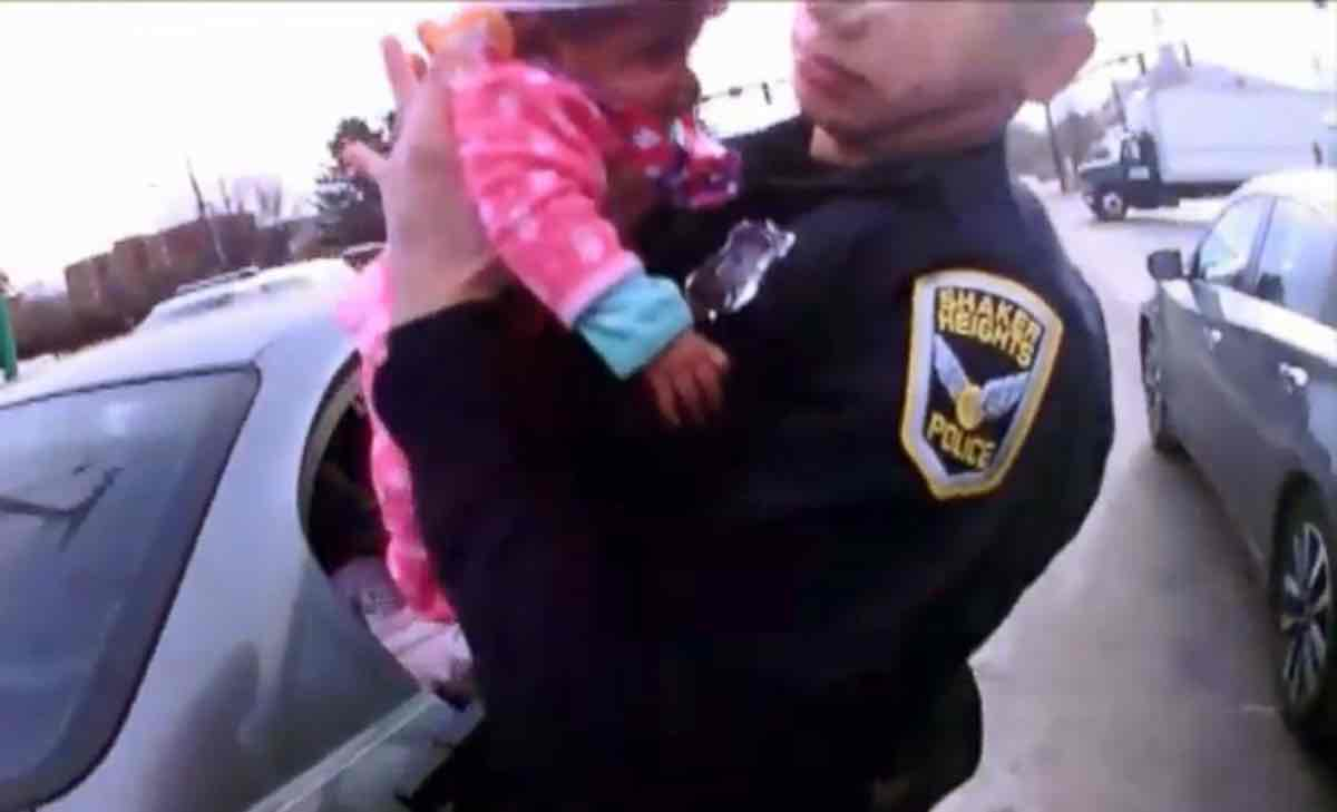 Two police officers save a choking baby in a busy intersection