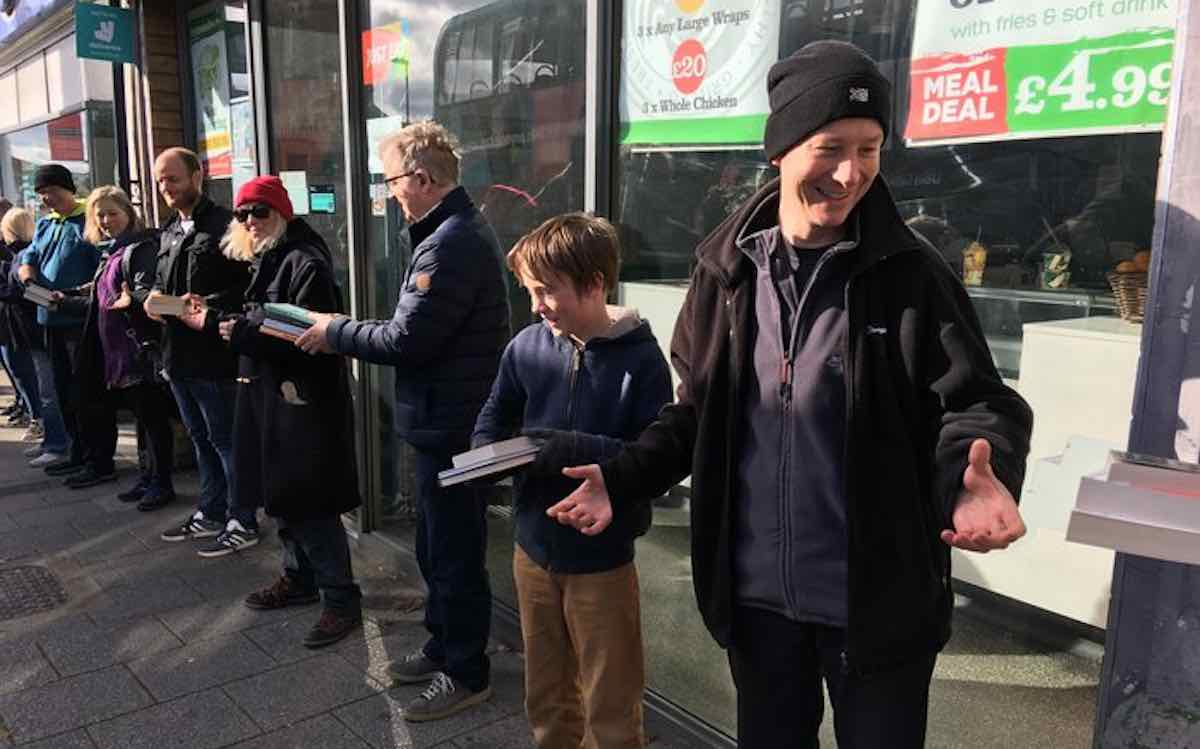 Human Chain of People Help Move A Bookstore, Book By Book