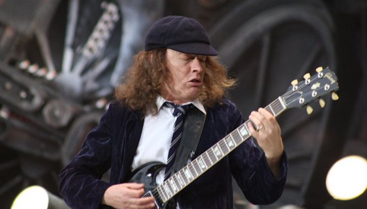 The 64-year old son of father (?) and mother(?) Angus Young in 2020 photo. Angus Young earned a  million dollar salary - leaving the net worth at  million in 2020