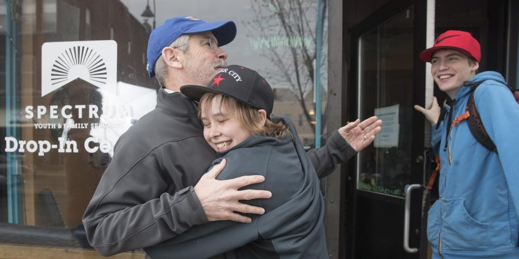 9b61422f Youth hug Mark Redmond at the Spectrum Youth Family Services Drop-In Center  in Burlington, VT. (By James Buck Seven Days)