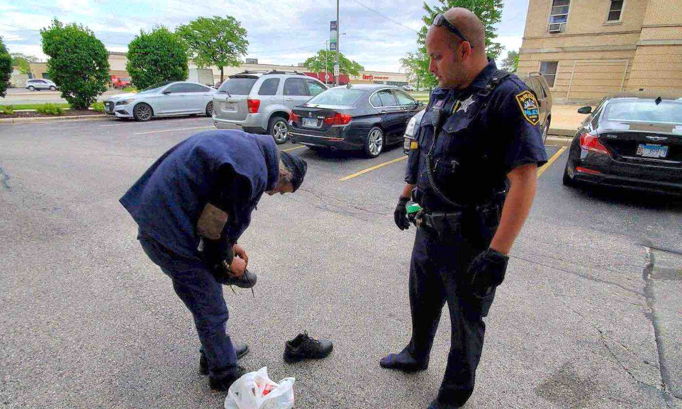 After Seeing Homeless Man Trip On Worn-Out Shoes, Policeman Hands Him the Pair Off His Own Feet