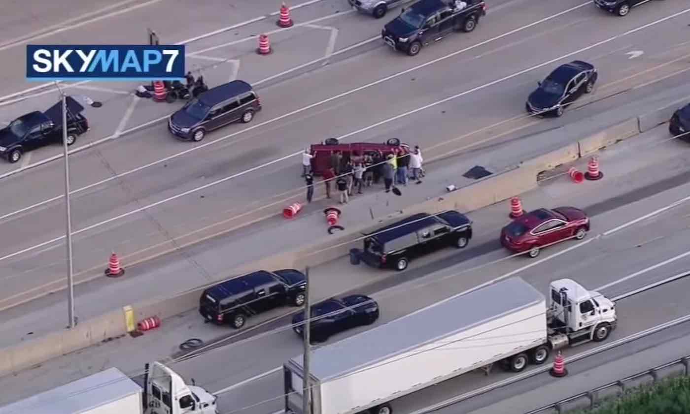 Watch Group of Good Samaritans Rush to Flip Overturned Truck