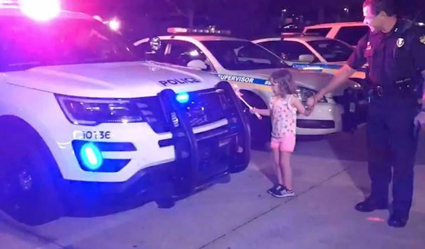 Watch This Adorable Little Girl Light Up Police Cars With Her 'Magic' Wand (#TBT)
