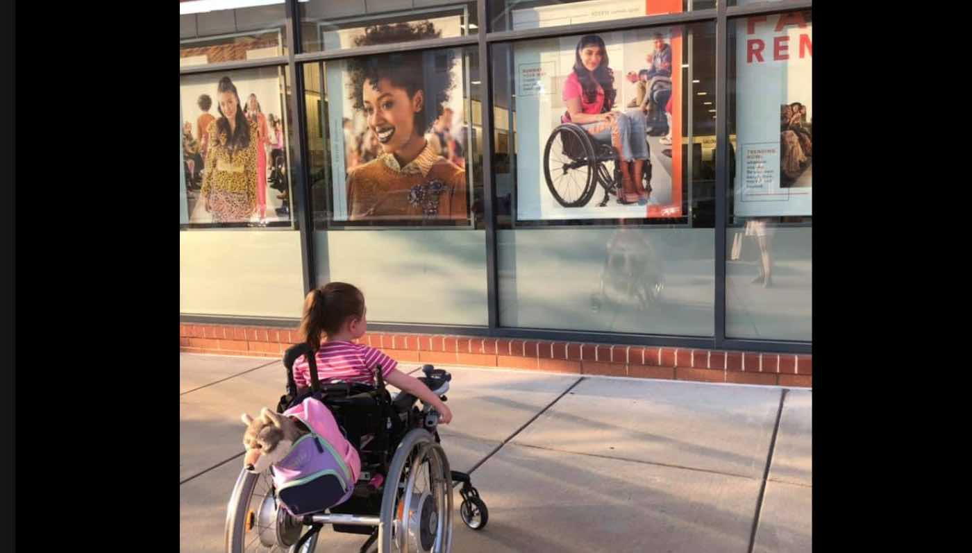 Hearts Are Melting Over Little Girl Admiring a Beauty Ad Depicting Woman in a Wheelchair