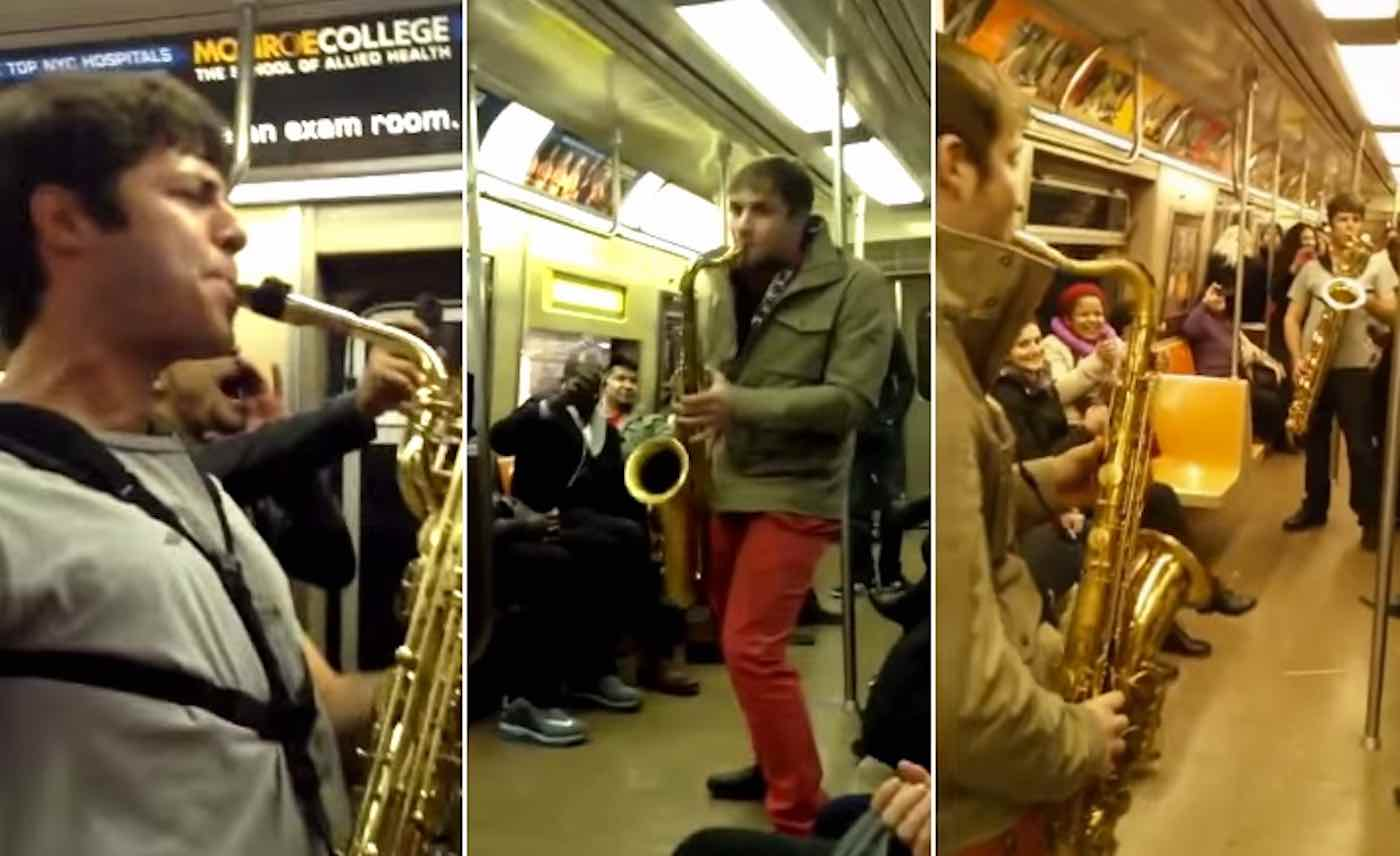 Watch Two Total Strangers Face Off for the Most Epic Saxophone Battle On the NYC Subway (#TBT)