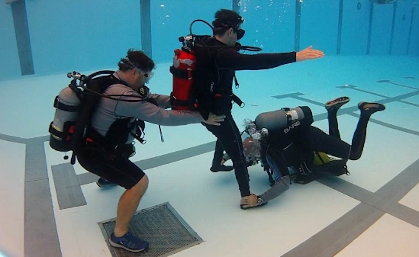 Father Uses Scuba Therapy to Restore His Paralyzed Son's